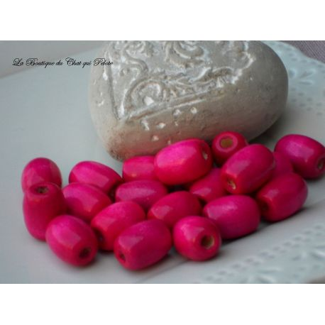 DESTOCKAGE - 20 perles en bois fuschia 16 x 14 mm