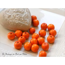 DESTOCKAGE - 20 perles en bois orange 14 mm